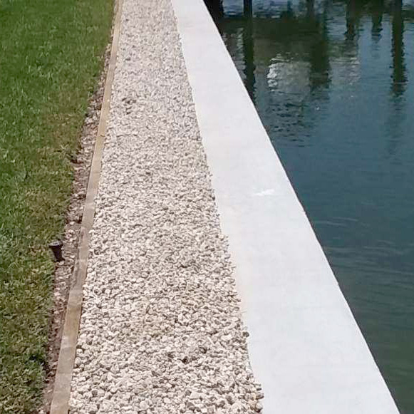Pelican Rock Company Rock Delivery Marco Island | Landscaping Stone on Seawall